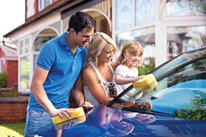 Family washing their car