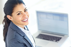 professional woman in front of an open laptop