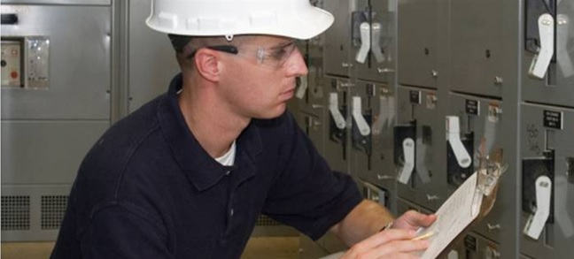 man inspecting electrical