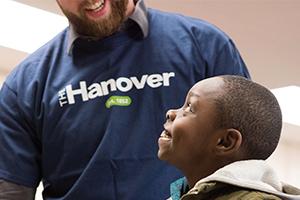 Hanover volunteer helping a child