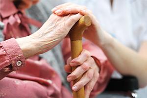 Elderly lady holding a cane