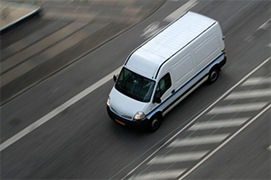 White van driving on the road