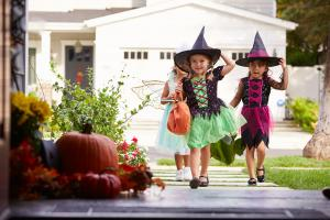 Trick or treaters safely entering a home.