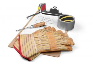 Gloves, tools, and a clipboard