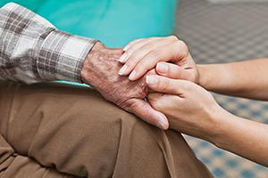 Holding elderly persons hand