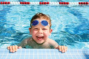 Boy in the pool smiling