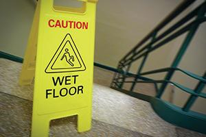 Wet floor sign near stairs