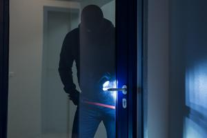burglar breaking into office
