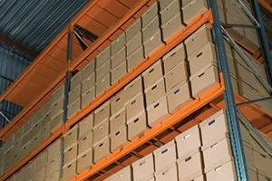 Inside of a warehouse with shelves containing multiple document size boxes