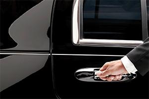 Limousine driver opening the car door