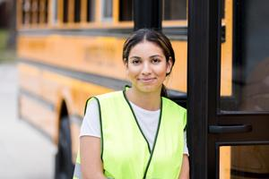 woman standing near school bus