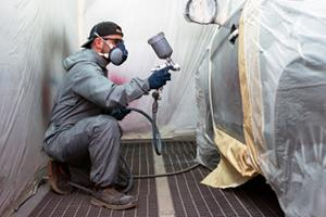 man working in a spray booth